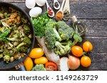 fresh broccoli and orange... | Shutterstock . vector #1149263729