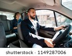 similing taxi driver talking... | Shutterstock . vector #1149287006