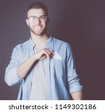 young man holding a credit card ... | Shutterstock . vector #1149302186