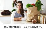young woman holding grocery... | Shutterstock . vector #1149302540