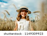 laughing baby girl running in a ... | Shutterstock . vector #1149309923