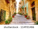typical narrow street with... | Shutterstock . vector #114931486