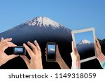 many people lift hands up to... | Shutterstock . vector #1149318059