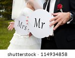 couple hold card with text mr... | Shutterstock . vector #114934858
