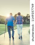 senior couple holding hands and ... | Shutterstock . vector #1149357749