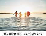 rearview of a diverse group of... | Shutterstock . vector #1149396143