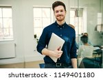 young businessman smiling... | Shutterstock . vector #1149401180