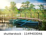 old wooden boats at the pier   Shutterstock . vector #1149403046