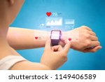 female hand with smartwatch and ... | Shutterstock . vector #1149406589