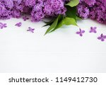 lilac flowers on a white wooden ... | Shutterstock . vector #1149412730