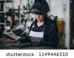 strong and worthy woman welder... | Shutterstock . vector #1149446510