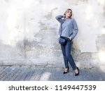 fashion. young woman in a... | Shutterstock . vector #1149447539