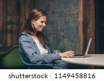 working smiling woman with... | Shutterstock . vector #1149458816