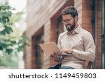 young businessman with laptop... | Shutterstock . vector #1149459803