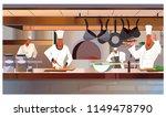 cooks working at restaurant... | Shutterstock .eps vector #1149478790