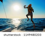 a little girl in a life jacket... | Shutterstock . vector #1149480203