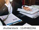 businesswoman using calculator... | Shutterstock . vector #1149482246