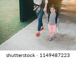 mother and pupil kids holding... | Shutterstock . vector #1149487223
