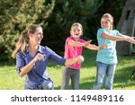 happy mother with children... | Shutterstock . vector #1149489116