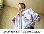 attractive man dressing up and... | Shutterstock . vector #1149503309