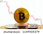 bitcoin btc on stack of... | Shutterstock . vector #1149505379
