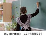 the student in uniform writes... | Shutterstock . vector #1149555389