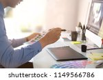 graphic designer working with... | Shutterstock . vector #1149566786