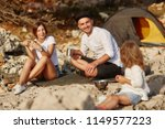 happy young parents sitting on... | Shutterstock . vector #1149577223