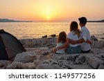 back view of cute young family  ...   Shutterstock . vector #1149577256