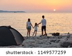 back view of sweet young family ...   Shutterstock . vector #1149577259