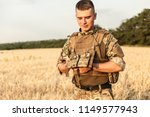 soldier man standing against a... | Shutterstock . vector #1149577943