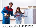man repairing fridge with... | Shutterstock . vector #1149599030