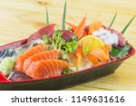 mixed sashimi set in red boat...   Shutterstock . vector #1149631616
