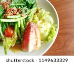 bowl of caesar salad on the... | Shutterstock . vector #1149633329