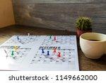 thumbtack in calendar concept... | Shutterstock . vector #1149662000