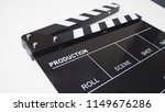 Small photo of Clapperboard or clap board, movie slate use in video production,film and cinema industry. It's black color on white background.