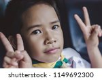 kid scout's face two hands... | Shutterstock . vector #1149692300