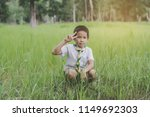 kid scout sit and lift two... | Shutterstock . vector #1149692303