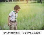 kid scout stand and lean... | Shutterstock . vector #1149692306
