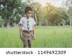 kid scout standing on green... | Shutterstock . vector #1149692309