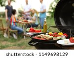 modern grill with meat and... | Shutterstock . vector #1149698129
