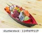 mixed sashimi set in red boat...   Shutterstock . vector #1149699119