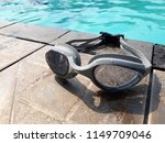 swimming goggles at poolside | Shutterstock . vector #1149709046