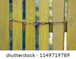 rusty chain on wooden yellow... | Shutterstock . vector #1149719789