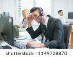 smiling handsome businessman in ...   Shutterstock . vector #1149728870