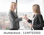 business woman offering coffee... | Shutterstock . vector #1149732503