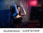 happy cheerful cute sexy gamer... | Shutterstock . vector #1149767459