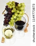 red and white wine and grapes | Shutterstock . vector #1149773873