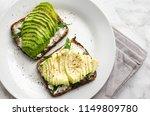 avocado toasts on rye bread... | Shutterstock . vector #1149809780