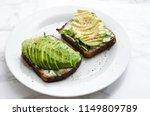 avocado toasts on rye bread... | Shutterstock . vector #1149809789